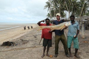 Ed Stafford with local fishermen. That morning's catch from the nets.
