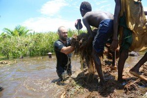 Ed Stafford and villagers of Yeobi building a mud island (Bedeng).